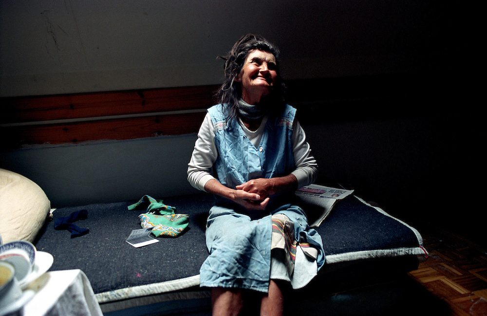 Milka in her small room - the only window is a small sky light above her, she is all alone, except for one son who stays in another room. The other residents gossip that Milka has been in a mental hospital. ..Hotel Lokve, a mountain ski hotel in Montenegro became the home of a diverse group of 60 refugees after the Kosovo refugee crisis.