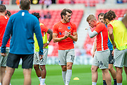 John Marquis (#10) of Portsmouth FC speaks to his team mates during the warm up before the EFL Sky Bet League 1 match between Sunderland and Portsmouth at the Stadium Of Light, Sunderland, England on 17 August 2019.