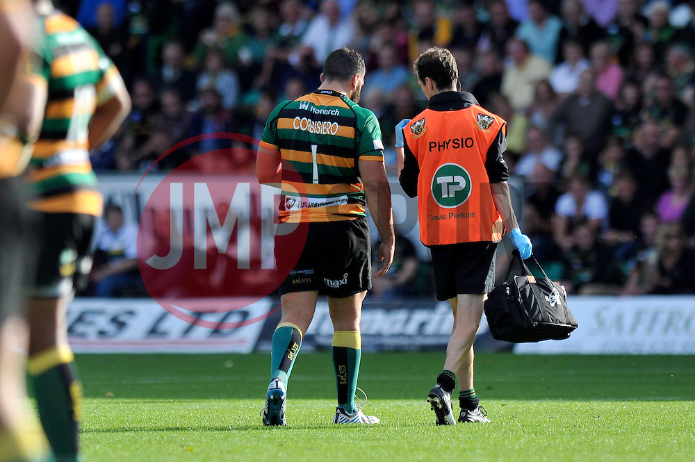 Alex Corbisiero of Northampton Saints is led from the field after suffering an injury - Photo mandatory by-line: Patrick Khachfe/JMP - Mobile: 07966 386802 27/09/2014 - SPORT - RUGBY UNION - Northampton - Franklin's Gardens - Northampton Saints v Bath Rugby - Aviva Premiership