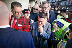 © Licensed to London News Pictures . 27/09/2018. London, UK. Former EDL leader Tommy Robinson (real name Stephen Yaxley-Lennon )  arrives at The Old Bailey for a retrial for Contempt of Court following his actions outside Leeds Crown Court in May 2018 . Robinson was already serving a suspended sentence for the same offence when convicted in May and served time in jail as a consequence , but the newer conviction was quashed by the Court of Appeal and a retrial ordered . Photo credit: Peter Macdiarmid/LNP