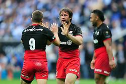 Marcelo Bosch of Saracens high fives team-mate Richard Wigglesworth - Mandatory byline: Patrick Khachfe/JMP - 07966 386802 - 14/05/2016 - RUGBY UNION - Grand Stade de Lyon - Lyon, France - Saracens v Racing 92 - European Rugby Champions Cup Final.