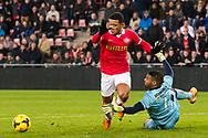 EINDHOVEN, PSV - ADO Den Haag, voetbal Eredivisie, seizoen 2013-2014, 22-12-2013, Philips Stadion, ADO Den Haag keeper Gino Coutinho (R) haalt PSV speler Memphis Depay (L) onderuit, penalty tegen en rode kaart.