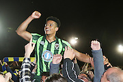 AFC Wimbledon make the final, Lyle Taylor forward for AFC Wimbledon (33) gets lifted by the fans the Sky Bet League 2 play-off 2nd leg match between Accrington Stanley and AFC Wimbledon at the Fraser Eagle Stadium, Accrington, England on 18 May 2016. Photo by Stuart Butcher.
