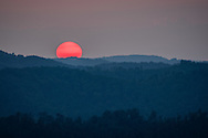 The sun sets over the Kentucky mountains from an overlook at Kingdom Come State Park.