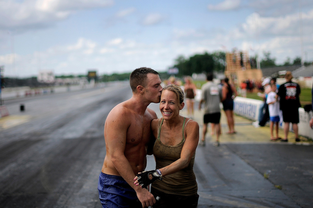 A couple embrace each other after crossing the finish line of the Rock Solid Mud Run held at Old Bridge Township Raceway Park in Englishtown on August 6. Rock Solid Mud Run is an all-terrain adventure that involves mastering obstacles along either a five or ten-mile course. Participants ran, swam, crawled, climbed, jumped while covering four motocross tracks, hundreds of acres of woods, three lakes, and two asphalt racetracks.