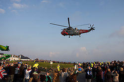 © Licensed to London News Pictures. 19/05/2012. Lands End, UK. Royal Navy Westland Sea King from 771 Squadron at RNAS Culdrose lands at Lands End with the  London 2012 Olympic Torch on board. The torch leaves Lands End today to be carried across the UK by 8,000 Torchbearers, arriving at the Olympic Stadium on July 27th. Photo credit : Ashley Hugo/LNP