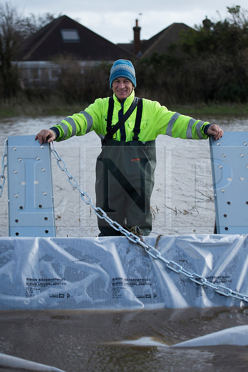 &copy; London News Pictures. Staines, UK. 15/02/2014.<br /> STEN-MAGNUS KULLBERG, pictured stood next to the  Geodesign flood barriers he designed, which are currently being installed along the River Thames at  Staines, where flood water is threatening properties. The barriers have been imported from Sweden..  Photo credit: Ben Cawthra/LNP
