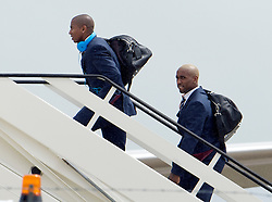 © London News Pictures. 06/06/2012. Luton, UK.   England players Ashley Young (left) and Jermaine Defoe (right) boarding a plane at Luton Airport in Bedfordshire on June 6, 2012 to head to Poland for the Euro 2012 football tournament. The squads training camp is based in Krakow.  Photo credit: Ben Cawthra/LNP