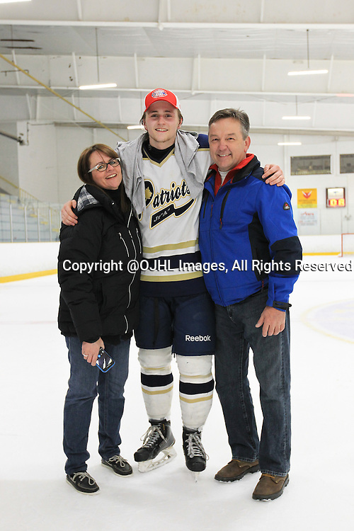 TORONTO, ON - Apr 22, 2015 : Ontario Junior Hockey League game action between the Toronto Patriots and the Kingston Voyageurs. Game seven of the Buckland Cup Championship Series. Players and Family members.<br /> (Photo by Tim Bates / OJHL Images)