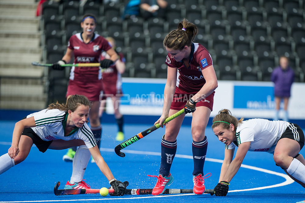 Wimbledon's Sophie Bowden is tackled by Leanne Grimsley and Lauren Thomas of Buckingham. Wimbledon v Buckingham - Investec Women's Hockey League Finals, Lee Valley Hockey & Tennis Centre, London, UK on 23 April 2017. Photo: Simon Parker