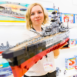 A woman holds up a model of the German WW@ pocket battleship Bismarck at the Toy Fair at Kensington Olympia in London is the UK's largest dedicated game and hobby exhibition featuring the hottest and most anticipated products for the year ahead. London, January 22 2019.