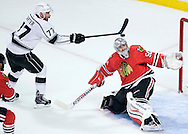 The Kings' Jeff Carter scores on Blackhawks' goaltender Corey Crawford during the first period of Game 7 of the Western Conference Final of the 2014 NHL Stanley Cup Playoffs at the United Center in Chicago Sunday night.
