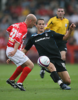 Photo: Rich Eaton.<br /> <br /> Cheltenham Town v Nottingham Forest. Coca Cola League 1. 13/10/2007. Forest's Chris Cohen (R) slots the ball past Alan Wright (L).