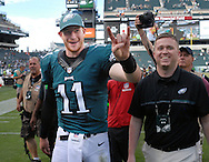 Philadelphia Eagles quarterback Carson Wentz #11 walks off the field after defeating the Cleveland Browns Sunday, September 11, 2016 at Lincoln Financial Field in Philadelphia, Pennsylvania.  (Photo by William Thomas Cain)