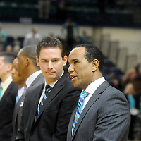 UNCW Men's Basketball Head Coach Kevin Keatts, right talks to Assistant Coach Casey Stanley before their game against St. Andrews Wednesday December 3, 2014 at Trask Coliseum in Wilmington, N.C. (Jason A. Frizzelle)