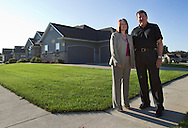 Beth and Jeff Kurth outside their house in Marion, Iowa on Monday, August 20, 2012. .