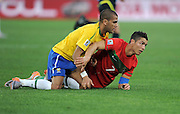 CRISTIANO RONALDO  and Dani Alves take a lie down during the 2010 FIFA World Cup South Africa Group G match between Portugal and Brazil at Durban Stadium on June 25, 2010 in Durban, South Africa.