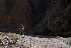 Motorcyclist on Titus Canyon Road, Death Valley National Park, California, United States of America