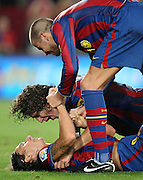 FC Barcelona's Zlatan Ibrahimovic (d), Carles Puyol (c) and Gerard Pique celebrate goal during La Liga match.August 31 2009.