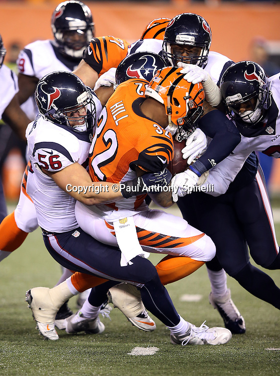 Houston Texans inside linebacker Brian Cushing (56) and teammates gang tackle Cincinnati Bengals running back Jeremy Hill (32) during the 2015 week 10 regular season NFL football game against the Cincinnati Bengals on Monday, Nov. 16, 2015 in Cincinnati. The Texans won the game 10-6. (©Paul Anthony Spinelli)
