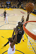 April 30, 2019; Oakland, CA, USA; Golden State Warriors forward Draymond Green (23) shoots the basketball against Houston Rockets guard Chris Paul (3) during the first half in game two of the second round of the 2019 NBA Playoffs at Oracle Arena. The Warriors defeated the Rockets 115-109.