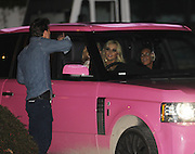 19.OCTOBER.2011 LONDON<br /> <br /> KATIE PRICE LEAVING ELSTREE STUDIOS AFTER ATTENDING THE UK FILM PREMIER OF PARANORMAL ACTIVITY 3. KATIE STOPED A LOCAL PETROL STATION IN HER PINK RANGE ROVER WITH NUMBER PLATE KP11 LEO AND REFUSED TO GET OUT OF THE CAR AND MADE HER FREINDS FILL HER CAR UP AND PAY BEFORE TRYING TO DRIVE AWAY DANGEROUSLEY BY COVERING HER FACE WITH HER JACKET AND NEARLY DRIVING INTO THE PETROL STATION STORE IN FRONT OF WATCHING POLICE. <br /> <br /> BYLINE: EDBIMAGEARCHIVE.COM<br /> <br /> *THIS IMAGE IS STRICTLY FOR UK NEWSPAPERS AND MAGAZINES ONLY*<br /> *FOR WORLD WIDE SALES AND WEB USE PLEASE CONTACT EDBIMAGEARCHIVE - 0208 954 5968*