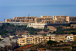 MALTA GOZO NADUR 20JUL06 - General view of Fort Chambray, a new housing development overlooking Mgarr harbour...jre/Photo by Jiri Rezac..© Jiri Rezac 2006..Contact: +44 (0) 7050 110 417.Mobile:  +44 (0) 7801 337 683.Office:  +44 (0) 20 8968 9635..Email:   jiri@jirirezac.com.Web:    www.jirirezac.com