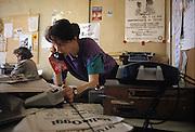 Enrica Toninelli, journalist, at work in the newsroom of Radio Popolare (Popular Radio) at the headquarter in Santo Stefano square, Milan, 1991. Radio Popolare is an Italian free and indipendent radio station; its programs are broadcasted on FM and streaming and by satellite. &copy; Carlo Cerchioli<br /> <br /> Enrica Toninelli, al lavoro nella redazione di Radio Popolare nella sede in piazza Santo Stefano, Milano, 1991. Radio Popolare, &egrave; una radio di informazione libera e indipendente; i suoi programmi sono trasmessi in FM e streaming e via satellite.