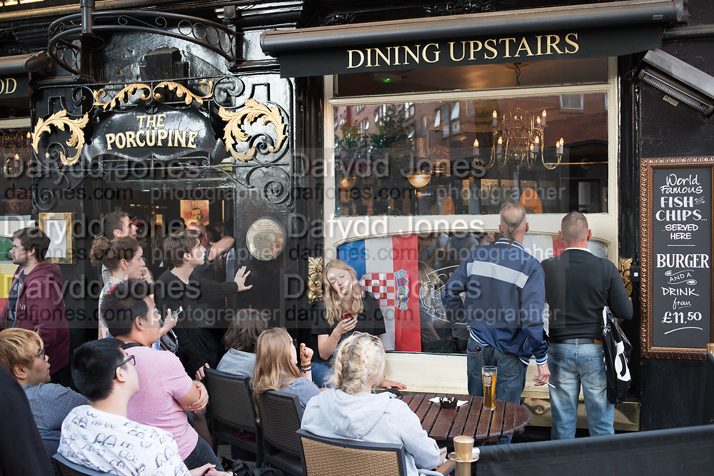 Watching football match between England and Croatia, Leicester Sq. London, 11 July 2018