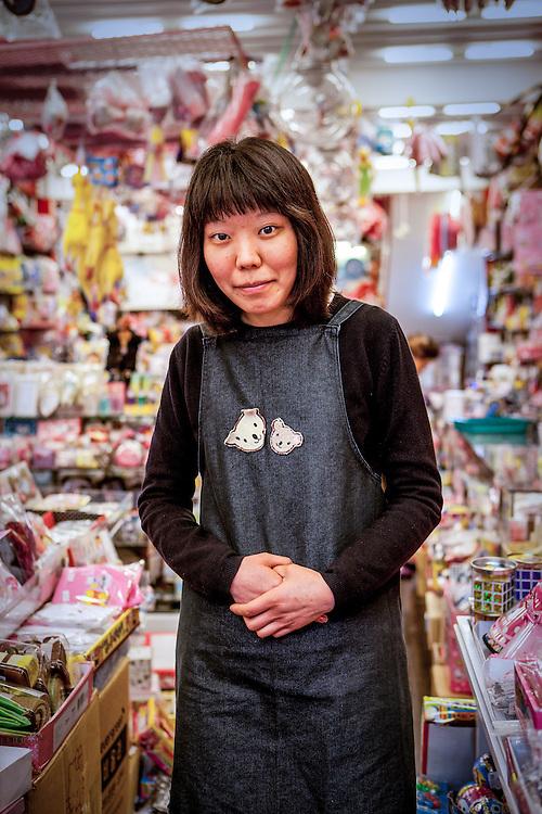 Portrait of a shop assistant in Daegu, South Korea.