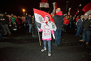 8 year old Amy Seddon of Sale, Cheshire, wears a t-shirt reading 'I should be in bed', joining many FC United of Manchester supporters staying outside the stadium until half time in a protest over the FA's decision to move the fixture to a Monday night, before the FA Cup match at Broadhurst Park, Moston<br /> Picture by Russell Hart/Focus Images Ltd 07791 688 420<br /> 09/11/2015
