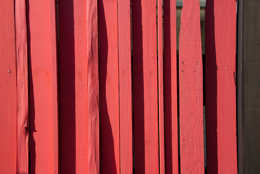 Red wooden fence detail
