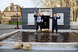 © licensed to London News Pictures. London, UK 20/03/2014. Two Greenpeace protesters posing as Nick Clegg and David Cameron at Old Palace Yard in London as they hold a photo-call to urge David Cameron to argue for stronger climate deal at a high-level EU summit by highlighting the recent floods in southern England. Photo credit: Tolga Akmen/LNP