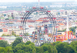 THEMENBILD - Das Wiener Riesenrad ist ein 64.75 Meter großes Riesenrad am Eingang zum Freizeitpark Prater in Leopoldstadt, dem 2. Bezirk von Österreichs Hauptstadt Wien. Es ist eines der populärsten Touristenziele in Wien und ist eines der Wahrzeichen der Stadt. Es wurde 1897 gebaut und war von 1920 bis 1965 das größte Riesenrad der Welt, im Bild das Riesenrad. Aufgenommen vom Uniqa Tower am 06. Juni 2017 // The Wiener Riesenrad (German for Vienna Giant Wheel) is a 64.75-metre tall Ferris wheel at the entrance of the Prater amusement park in Leopoldstadt, the 2nd district of Austria's capital Vienna. It is one of Vienna's most popular tourist attractions, and symbolises the district as well as the city for many people. Constructed in 1897, it was the world's tallest extant Ferris wheel from 1920 until 1985, This picture was taken from the Uniqa Tower and shows the Riesenrad, Vienna, Austria on 2017/06/06. EXPA Pictures © 2017, PhotoCredit: EXPA/ Sebastian Pucher