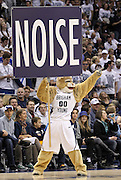 The BYU Cougars mascot holds a sign during a timeout in the first half of an NCAA college basketball game against St. Mary's in Provo, Utah, Saturday, Jan. 28, 2012. (AP Photo/Colin E Braley)