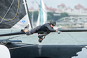 Emirates Team New Zealand wins race one of the Extreme Sailing Series regatta being sailed in Singapore. Under 20 sailor Edwin De Laat on the bow sprit. 20/2/2014