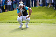 French golf professional Victor Dubuisson lines his putt up at the  BMW PGA Championship at the Wentworth Club, Virginia Water, United Kingdom on 27 May 2016. Photo by Simon Davies.