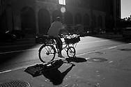 Sao Paulo, Brazil, Thursday - March 08, 2012: Butcher's shop delivery service, by bike, at Paulista avenue.  (photo: Caio Guatelli)