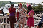 SUSAN BENDER; PEARL LOWE; ; Daniella Issa Helayel;  , Glorious Goodwood. Ladies Day. 28 July 2011. <br /> <br />  , -DO NOT ARCHIVE-© Copyright Photograph by Dafydd Jones. 248 Clapham Rd. London SW9 0PZ. Tel 0207 820 0771. www.dafjones.com.