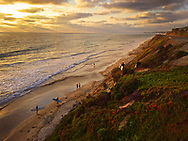 Surfers leaving and walking up the bluffs in Del Mar, CA at sunset. - San Diego Lifestyle Photographer, San Diego Lifestyle Photographers