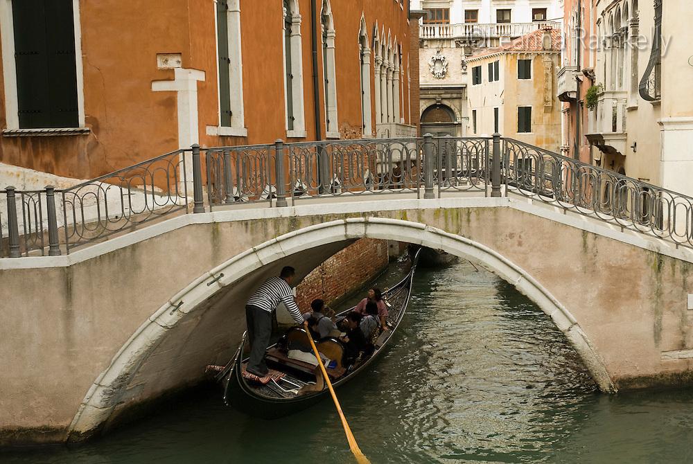 Gondola boats ply the narrow canals of Venice, Italy.