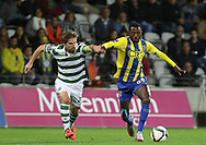 Sporting's midfielder Adrien (L )  vies with União da Madeira midfielder Gian Martins   (R ) during Portuguese first league football match União vs Sporting held at Madeira stadium in Funchal on December 20, 2015.  LUSA / GREGORIO CUNHA