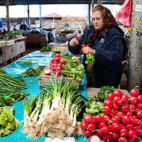 TIMISOARA, ROMANIA - APRIL 21:  A market seller at her stall of vegetables in one of the daily markets  on April 21, 2013 in Timisoara, Romania.  Romania has abandoned a target deadline of 2015 to switch to the single European currency and will now submit to the European Commission a programme on progress towards the adoption of the Euro, which for the first time will not have a target date. (Photo by Marco Secchi/Getty Images)