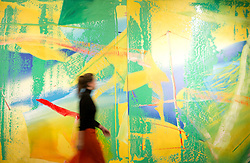 """© Licensed to London News Pictures. 22/02/2018. LONDON, UK. A member of staff walks pass  """"Gelbrün"""" (1982) by Gerhard Richter with an estimate of £7,000,000 - 10,0000, on display at Sotheby's photo call for highlights from their forthcoming sales of Impressionist, Modern, Surrealist and Contemporary Art. Photo credit: ISABEL INFANTES/LNP"""