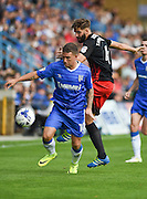 Gillingham forward Cody MacDonald (10) and Coventry City defender Jordan Turnbull (4) during the EFL Sky Bet League 1 match between Gillingham and Coventry City at the MEMS Priestfield Stadium, Gillingham, England on 24 September 2016. Photo by Martin Cole.