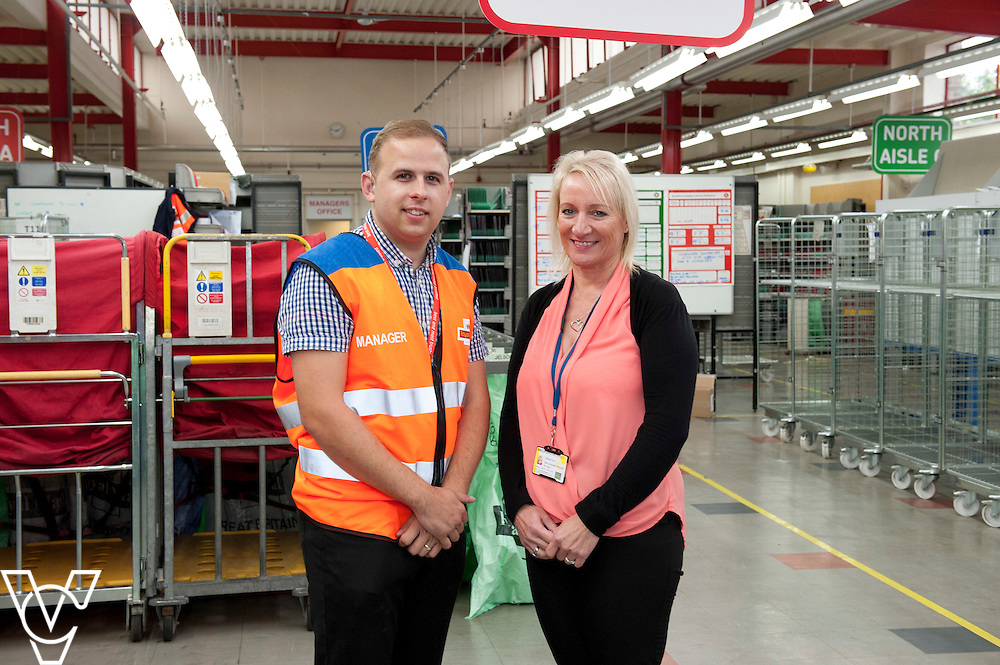Pictured is James Wright, left, with registered sign language interpreter Debbie Kirk<br /> <br /> James Wright is a deaf former postman who has worked his way into a management position at Leicester North Delivery Office to become on of, if not the, only deaf person employed in management by Royal Mail.<br /> <br /> Date: September 21, 2015