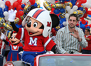 Feb 7, 2011;  Lake Buena Vista, FL, USA;  Green Bay Packers quarterback and Super Bowl XLV MVP Aaron Rodgers participates in a ticker-tape parade on Main Street at Walt Disney World's Magic Kingdom.