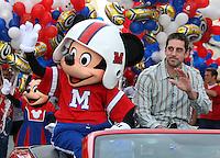 Feb 7, 2011;  Lake Buena Vista, FL, USA;  Green Bay Packers quarterback and Super Bowl XLV MVP Aaron Rodgers participates in a ticker-tape parade on Main Street at Walt Disney World's Magic Kingdom.
