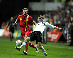 Florin Klein (Red Bull Salzburg) of Austria  struggles under pressure from Jack Collison (West Ham United) of Wales  - Photo mandatory by-line: Joe Meredith/JMP - Tel: Mobile: 07966 386802 06/02/2013 - SPORT - FOOTBALL - Liberty Stadium - Swansea  -  Wales V Austria - International Friendly