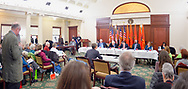 Mineola, New York, USA. 15th Feb, 2019. Invited speaker addresses  (L-R, at table) NYS Senator JOHN BROOKS, Assemblyman STEVE ENGLEBRIGHT, NYS Sen. TODD KAMINSKY, NYS Sen, KEVIN THOMAS, and Assemblywoman JUDY GRIFFIN, during NYS Senate Public Hearing on Climate, Community & Protection Act, Bill S7253, sponsored by Sen. Kaminsky, Chair of Senate Standing Committee on Environmental Conservation. This 3rd public hearing on bill to fight climate change was on Long Island.